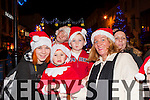 Alexandra and Dylan Treimut with John, Rowan and Mary O'Sullivan at the Christmas in Killarney parade on Friday night