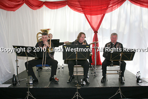 After the graduation ceremony, everyone celebrates with music and food in the marquee, University of Surrey.