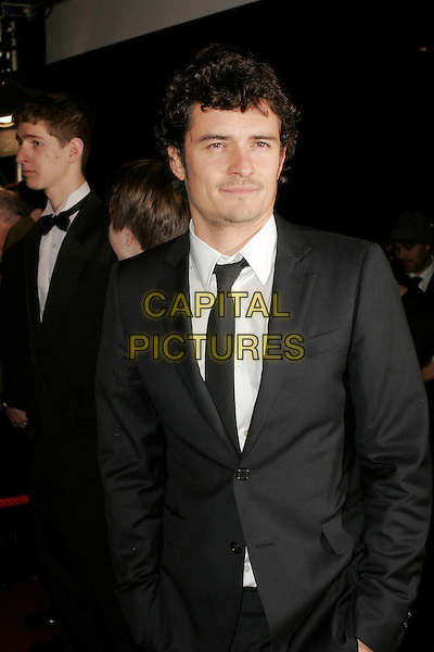 ORLANDO BLOOM.The Orange British Academy Film Awards in 2008 The Royal Opera House, Covent Garden, London, England. .February 10th, 2008 .BAFTA Arts half length black suit .CAP/AH.©Adam Houghton/Capital Pictures