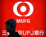A signboard of the Bank of Tokyo-Mitsubishi UFJ is seen on January 14, 2016 in Tokyo, Japan. Mitsubishi UFJ Financial Group Inc., Japans biggest bank, agreed to buy a 20 percent stake in Philippine lender Security Bank Corp. for the equivalent of $773 million as it continues its overseas push. MUFG already earns more overseas than it's domestic rivals and the move is expected to lead to further growth in SE Asia. (Photo by Shingo Ito/AFLO)