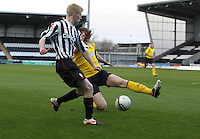 Jack Smith crossing as he is tackled by Ryan McGeever in the St Mirren v Falkirk Clydesdale Bank Scottish Premier League Under 20 match played at St Mirren Park, Paisley on 30.4.13. ..
