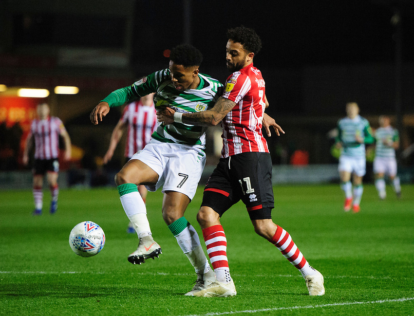 Lincoln City's Bruno Andrade vies for possession with Yeovil Town's Rhys Browne<br /> <br /> Photographer Chris Vaughan/CameraSport<br /> <br /> The EFL Sky Bet League Two - Lincoln City v Yeovil Town - Friday 8th March 2019 - Sincil Bank - Lincoln<br /> <br /> World Copyright © 2019 CameraSport. All rights reserved. 43 Linden Ave. Countesthorpe. Leicester. England. LE8 5PG - Tel: +44 (0) 116 277 4147 - admin@camerasport.com - www.camerasport.com