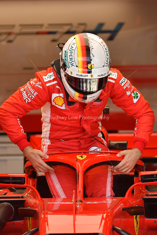 March 23, 2018: Sebastian Vettel (DEU) #5 from the Scuderia Ferrari team uses the new halo head protection to help him out of this car during practice session two at the 2018 Australian Formula One Grand Prix at Albert Park, Melbourne, Australia. Photo Sydney Low