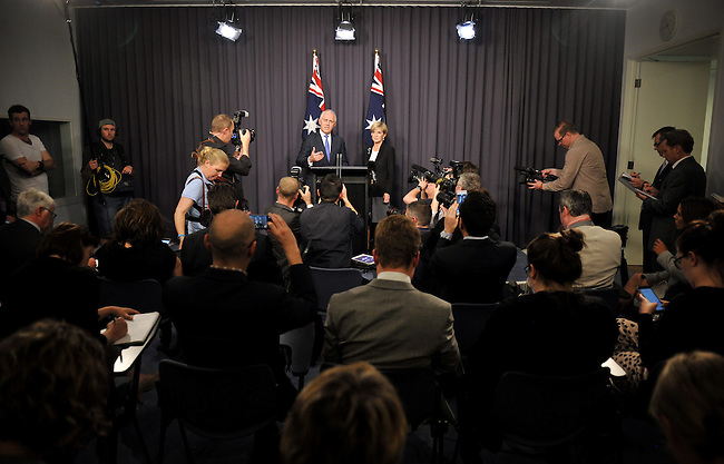 Malcolm Turnbull, (L) Australia's incoming prime minister, speaks with Foreign Minister Julie Bishop (R) during a news conference after winning a party leadership ballot in Canberra, Australia, on Monday, Sept. 14, 2015. Photographer: Mark Graham/Bloomberg *** Local Caption *** Malcolm Turnbull
