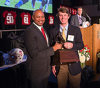 David Shaw, head coach of the Stanford Cardinal football team with Ben Rhyne Academic Achievement Award (Tommy Vardell Award) at the Football awards banquet on Sunday, December 8, 2013, on the Stanford University Campus.