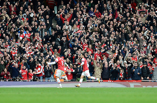17.11.2012. London, England. Lukas Podolski Of Arsenal  celebrates scoring during the Premier League game between Arsenal and Tottenham Hotspur from the Emirates Stadium...
