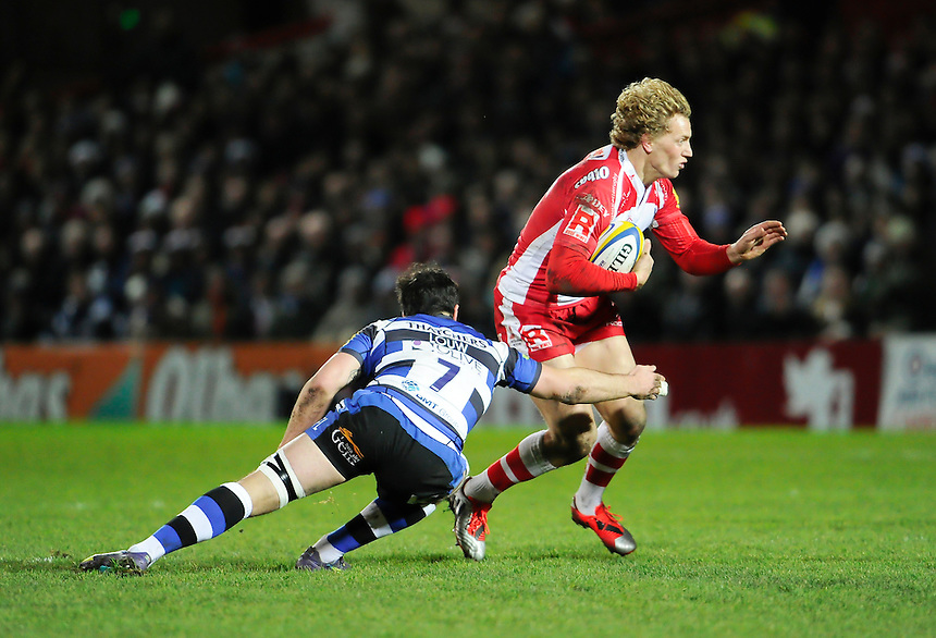 Gloucester Rugby's Billy Twelvetrees is tackled by Bath Rugby's Francois Louw<br /> <br /> Photographer Ashley Western/CameraSport<br /> <br /> Rugby Union - Aviva Premiership - Gloucester v Bath Rugby - Saturday 20th December 2014 - Kingsholm Stadium - Gloucester<br /> <br /> &copy; CameraSport - 43 Linden Ave. Countesthorpe. Leicester. England. LE8 5PG - Tel: +44 (0) 116 277 4147 - admin@camerasport.com - www.camerasport.com