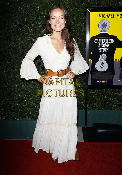 "OLIVIA WILDE.""Capitalism: A Love Story"" Los Angeles Premiere held At AMPAS Samuel Goldwyn Theater, Beverly Hills, California, USA..September 15th, 2009.full length white maxi dress brown leather belt gypsy hands on hips .CAP/ADM/KB.©Kevan Brooks/AdMedia/Capital Pictures."