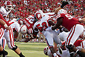 10 Sept 2011: Rex Burkhead #22 of the Nebraska Cornhuskers dives over the line for  one yard to score a touchdown against the Fresno State Bulldogs at Memorial Stadium in Lincoln, Nebraska. Nebraska defeated Fresno State 42 to 29.
