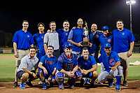 AZL Cubs coaching and training staff pose with the Chuck Jared Championship Cup after winning Game Three of the Arizona League Championship Series against the AZL Giants on September 7, 2017 at Scottsdale Stadium in Scottsdale, Arizona. AZL Cubs defeated the AZL Giants 13-3 to win the series two games to one. (Zachary Lucy/Four Seam Images)