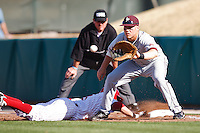 Jake Rowell (5) waits for the throw at first as the base runner dives back to the bag during the NCAA matchup between the University of Arkansas-Little Rock Trojans and the University of Oklahoma Sooners at L. Dale Mitchell Park in Norman, Oklahoma; March 11th, 2011.  Oklahoma won 11-3.  Photo by William Purnell/Four Seam Images