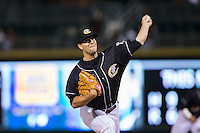 Charlotte Knights relief pitcher Jarrett Casey (10) in action against the Toledo Mud Hens at BB&T BallPark on April 27, 2015 in Charlotte, North Carolina.  The Knights defeated the Mud Hens 7-6 in 10 innings.   (Brian Westerholt/Four Seam Images)