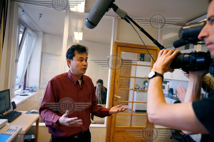 Assistant editor Khin Maung Win talks to journalists.  Democratic Voice of Burma is radio and TV station run by exiled Burmese. Opposing the government, the DVB has been transmitting, from the Norwegian capitol Oslo, into Burma since 1992.