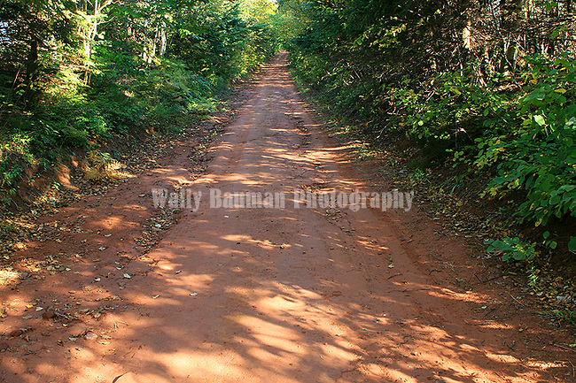 Red dirt road in P.E.I.    Canada.  Images of The Canadian Maritime Provinces of Nova Scotia and Prince Edward Island.