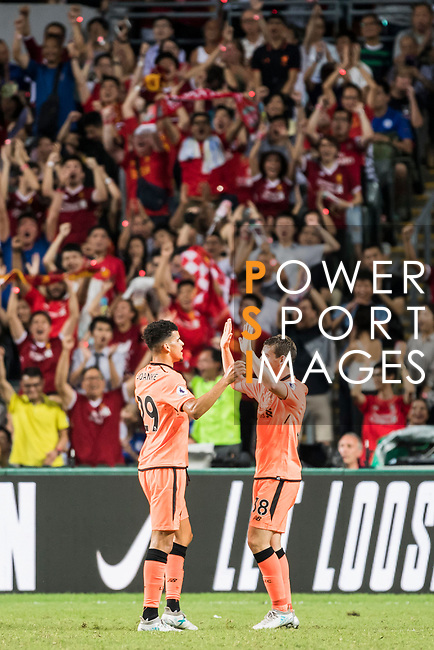 Liverpool FC forward Dominic Solanke (L) celebrates with teammate Jon Flanagan during the Premier League Asia Trophy match between Liverpool FC and Crystal Palace FC at Hong Kong Stadium on 19 July 2017, in Hong Kong, China. Photo by Weixiang Lim / Power Sport Images