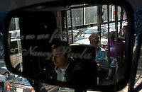 """Bus driver driving Mexico City's public transportation's """"Women Only"""" bus Mexico D.F., Mexico.  Wednesday, April 30, 2008"""