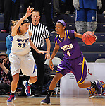 SIOUX FALLS, SD - MARCH 10:  Charnelle Reed #4 of Western Illinois drives toward Danielle Wilmoth #32 of IPFW during their game at 2013 Summit League Basketball Championships Sunday at the Sioux Falls Arena. (Photo by Dick Carlson/Inertia)