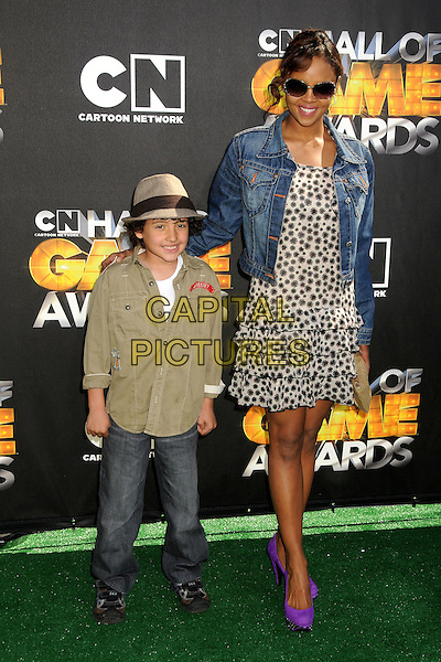 KAI MILES & SHARON LEAL.1st Annual Cartoon Network Hall of Game Awards held at Barker Hangar, Santa Monica, California, USA..February 21st, 2011.full length jacket dress beige shirt hat mother mom mum son family purple shoes blue white print sunglasses shades denim jean.CAP/ADM/BP.©Byron Purvis/AdMedia/Capital Pictures.