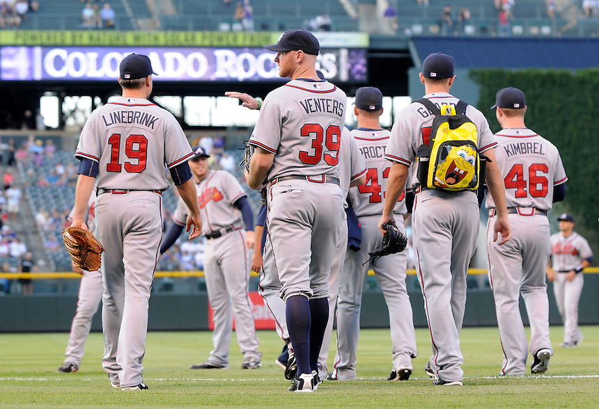 18 JULY 2011:  The Braves relief pitchers, including  relief pitcher Scott Linebrink (19),  relief pitcher Jonny Venters (39), relief pitcher Craig Kimbrel (46),  relief pitcher Scott Proctor (43), and  relief pitcher Cory Gearrin (53) (wearing the spongebob squarepants little kids backpack)   as they head out towards the bullpen during a regular season game between the Atlanta Braves and the Colorado Rockies at Coors Field in Denver, Colorado. The Braves beat the Rockies 7-4. *****For Editorial Use Only*****