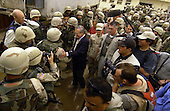 Unnited States Secretary of Defense Donald H. Rumsfeld shakes hands and poses for pictures with soldiers, Marines and airman outside the dining facility of the Abu Ghraib Detention Center in Iraq on May 13, 2004.  Rumsfeld and Chairman of the Joint Chiefs of Staff General  Richard B. Myers are in Iraq to visit the troops in Baghdad and Abu Ghraib.   <br /> Mandatory Credit: Jerry Morrison / DoD via CNP