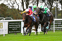 Caiya (green\white cap) ridden by Charles Bishop makes a move to win The Byerley Stud EBF Fillies' Novice Stakes    during Bathwick Tyres Reduced Admission Race Day at Salisbury Racecourse on 9th October 2017