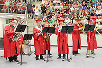 Farmington band seniors are featured in this song played on graduation night: (left to right) Mark Everett on tuba, Alejandro Sanchez on clarinet, Derek Salonen on tenor saxophone, Jackson Biswell on trumpet, Carl Dunlap on bass trombone, and Hunter Lockard on trombone. Alex Strickling is in the background on drum set.