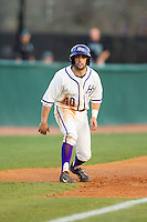 Tim Mansfield (40) of the High Point Panthers takes his lead off of third base against the Coastal Carolina Chanticleers at Willard Stadium on March 15, 2014 in High Point, North Carolina.  The Panthers defeated the Chanticleers 11-8 in game two of a double-header.  (Brian Westerholt/Four Seam Images)