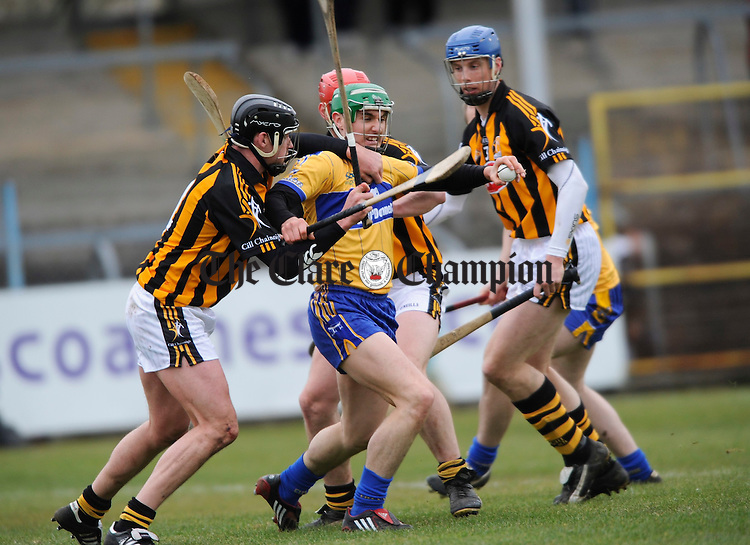 Kilkenny's Jackie Tyrell and  Brian Hogan combine efforts against Clare's Caimin Morey during their NHL game at Cusack Park. Photograph by John Kelly.
