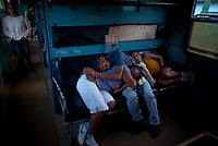 HAVANA, CUBA - JUNE 27: Cubans sleep during a trip to La Havana on June 27, 2013 in Cuba. Ferrocarriles de Cuba, is one of the oldest railroad around world, having opened its first route in 1837 with at least 17-mile long. Now the railway probably could cover more than 2,600 miles along the Island. (Photo by Eliana Aponte/VIEWpress)