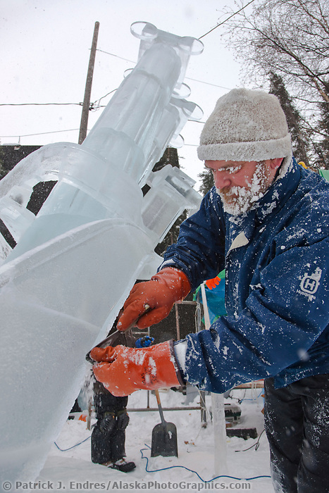 "Ice artist Vladimir Zhikhartsev works on ""Pandoras Box"" a multi-block sculpture that earned first place in the abstract category, 2009 World Ice Art Championships, Fairbanks, Alaska"