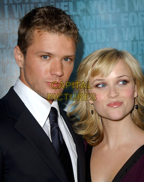"RYAN PHILLIPPE & REESE WITHERSPOON.Attends Lion Gate Films' Los Angeles Premiere of ""Crash"" held at The Academy of Motion Picture Arts and Sciences in Beverly Hills, California, USA, .April 26th 2005..portrait headshot married husband wife.Ref: DVS.www.capitalpictures.com.sales@capitalpictures.com.©Debbie VanStory/Capital Pictures"