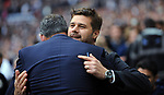 Tottenham Hotspur Manager Mauricio Pochettino hugs Swansea City Manager Paul Clement before the start of the premier league match at the Wembley Stadium, London. Picture date 16th September 2017. Picture credit should read: Robin Parker/Sportimage