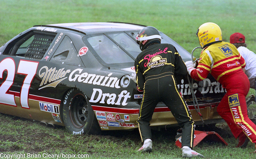 Mickey Gibbs and Rick Wilson help to push Rusty Wallaces' car after an early crash the Pepsi 400 at Daytona International Speedway, Daytona Beach, FL, July 7, 1990 (Photo by Brian Cleary/www.bcpix.com)