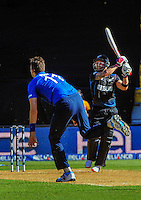 Brendon McCullum hits Steven Finn for six during the ICC Cricket World Cup one day pool match between the New Zealand Black Caps and England at Wellington Regional Stadium, Wellington, New Zealand on Friday, 20 February 2015. Photo: Dave Lintott / lintottphoto.co.nz