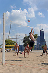 Young men and women play beach volleyball at North Avenue beach in Chicago, Illinois on August 18, 2008.