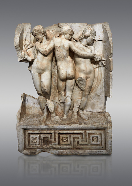 Roman Sebasteion relief  sculpture of the Three Graces, Aphrodisias Museum, Aphrodisias, Turkey. <br /> <br /> The Three Graces stand in their familiar hellenistic composition. They were handmaids of Aphrodite and appeared in this form on the decoration of her cult statue at Aphrodisias. Their names evoked their character: Euphrosyne (joy), Aglaia (Splendour) and Thaleia (Bloom).