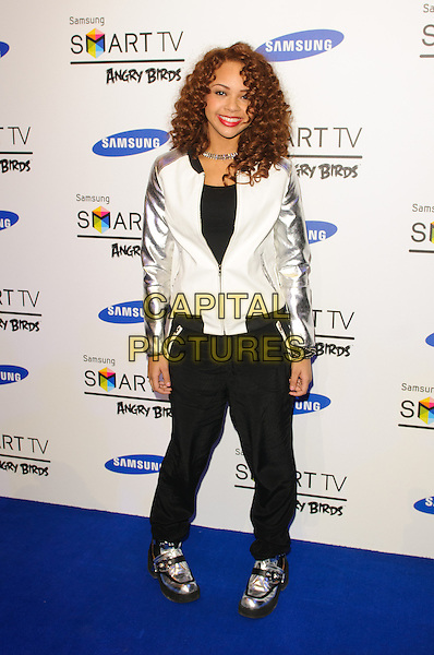 Alexis Jordan.Samsung Electronics Smart Tv Europe Party - Arrivals, London, England..13th December 2012.full length black white silver varsity jacket sleeves trousers shoes .CAP/CJ.©Chris Joseph/Capital Pictures.