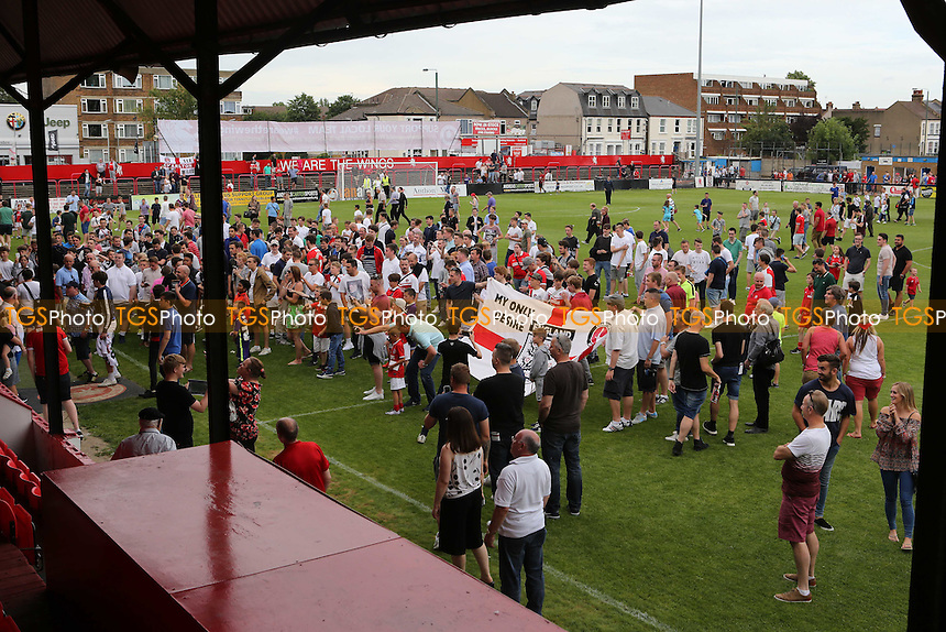 Charlton fans invade the pitch at the final whistle and show the 'Roland Out' banner to the people sitting in the away Directors Box during Welling United vs Charlton Athletic, Friendly Match Football at the Park View Road Ground on 9th July 2016
