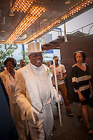 "Isaiah Owens, the owner of Owens Funeral Home, in Harlem in New York, on Friday, June 21, 2013, arrives at the Apollo Theater for a showing of Christine Turner's documentary film ""Homegoings"".  The film features Owens and his funeral home as it studies African-American traditions of death. Owens, who moved to New York in the 1960's, opened the funeral home and with just word of mouth and little advertising has become the paramount funeral home in Harlem, due to his care and understanding.  (© Richard B. Levine)"