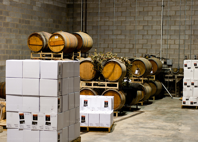 Barrels of fermenting wine and cases of the finished product are stacked neatly in the working spaces at Davis Valley Winery.