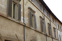 A row of shuttered windows in the facade of this 16th century restored palazzo indicates the location of Radi's apartment