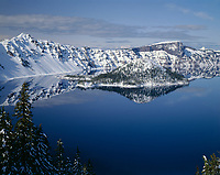 ORCL_010 - USA, Oregon, Crater Lake National Park, Winter snow on west rim of Crater Lake and Wizard Island.