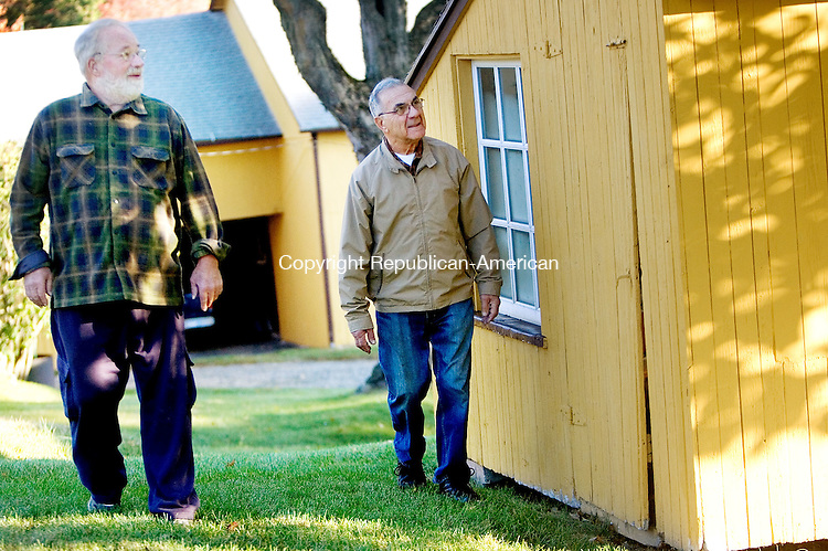 MIDDLEBURY CT. 08 October 2015-100815SV02-From left, Rob Fenn and Ray Pietrorazio, Land Preservation &amp; Open Space Acquisition Commission, look over a chicken coop in need of repair while touring the town-owned Fenn Farm in Middlebury Thursday. There have been recent improvements to the buildings on the farm and there are more needed. <br /> Steven Valenti Republican-American