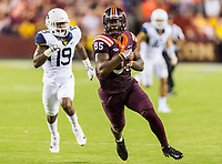 Landover, MD - SEPT 3, 2017: Virginia Tech Hokies tight end Chris Cunningham (85) catches a pass deep down the middle of the West Virginia Mountaineers defense during game between West Virginia and Virginia Tech at FedEx Field in Landover, MD. (Photo by Phil Peters/Media Images International)
