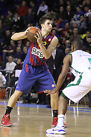 20.03.2012 Barcelona, Spain. Euroleague Playoff game 1. Picture show Xavier Rabaseda (L) and Terrel Lyday (R) in action during match between FC Barcelona Regal against Unics Kazan at Palau Blaugrana