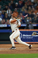 DJ Petrinsky (6) of the Texas Longhorns follows through on his swing against the Arkansas Razorbacks in game six of the 2020 Shriners Hospitals for Children College Classic at Minute Maid Park on February 28, 2020 in Houston, Texas. The Longhorns defeated the Razorbacks 8-7. (Brian Westerholt/Four Seam Images)