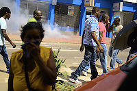 People watching and protecting their ears for preventing permanent damage due loud noise comes from explosion of hundred meters long of firecrackers, lays on the sidewalk of busy street.....End of year 2010 celebrations on the streets of Paramaribo. Suriname is one of biggest consumer in South America that using firecrackers, fireworks ( also locally known as pagara ) for celebrations, especially for end of every years and also beginning of every new Chinese Years.