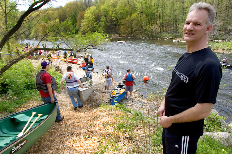 WATERBURY, CT. 05 May 2011-050711SV08--At right Dave Faber of Connecticut Outdoors makes sure all boaters get into the water safely at the Naugatuck River on Platts Mill Road in Waterbury Saturday. Kayakers and canoe racers paddled 6 miles from Waterbury to Beacon Falls during the 4th Annual Naugatuck Valley River Race and Festival. The event was sponsored Connecticut Outdoors, LLC and Beacon Falls Merchant Association.<br /> Steven Valenti Republican-American
