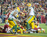 Washington Redskins running back Rob Kelley (32) scores a touchdown in the fourth quarter against the Green Bay Packers at FedEx Field in Landover, Maryland on Sunday, November 20, 2016.  Green Bay Packers free safety Ha Ha Clinton-Dix (21) and strong safety Morgan Burnett (42) try to keep him from scoring.  The Redskins won the game 42 - 24.<br /> Credit: Ron Sachs / CNP /MediaPunch