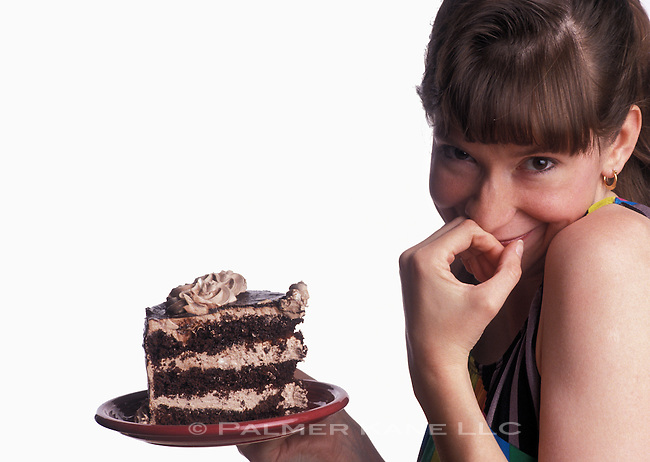 Woman with a huge piece of fattening chocolate cake